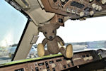 Muki bear  in the cockpit of the plane going to Italy